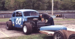 My dear old Dad, slaving over a hot racecar!